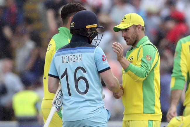 England captain Eoin Morgan, left, shakes hands with opposite number Aaron Finch