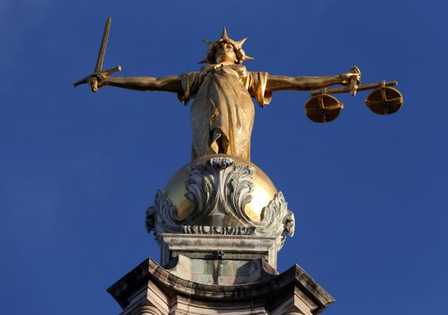 File photo dated 8/1/2019 of FW Pomeroy's Statue of Lady Justice atop the Central Criminal Court building at the Old Bailey, London. The number of people being prosecuted or handed out-of-court disposals is at its lowest since records began, while mo