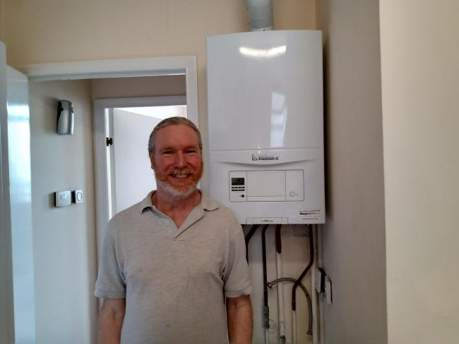 Peter Coles in front of his boiler, which is still not fixed