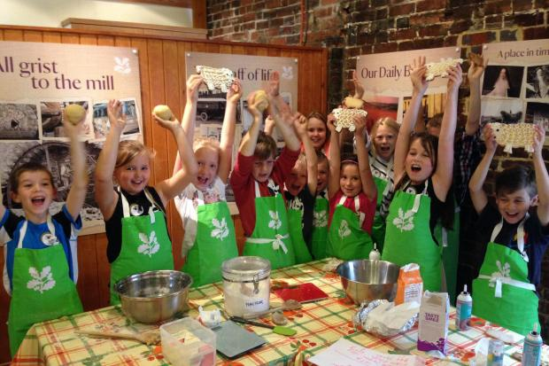 Winnall Primary School children making sheep-shaped biscuits at the launch of Winchester City Mill as a gateway to the South Downs National Park.