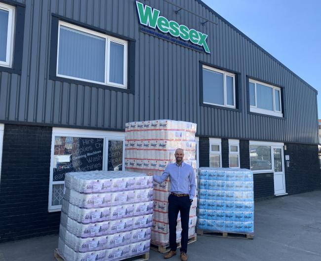 Mark Powell of Wessex Cleaning Equipment with stacks of toilet rolls