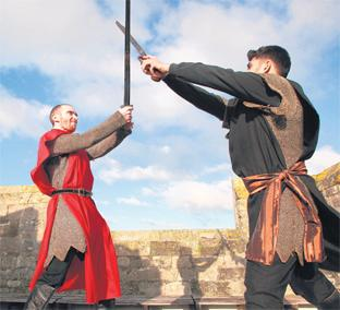 Dan Baker, left, as Sir Bevois takes on Amil, played by Badal Chaud, on the roof of God's House Tower.