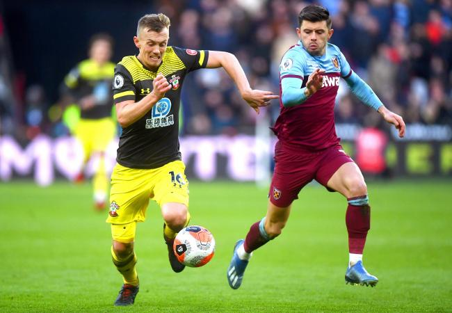 Southampton's James Ward-Prowse (left) and West Ham United's Aaron Cresswell battle for the ball during the Premier League match at London Stadium..