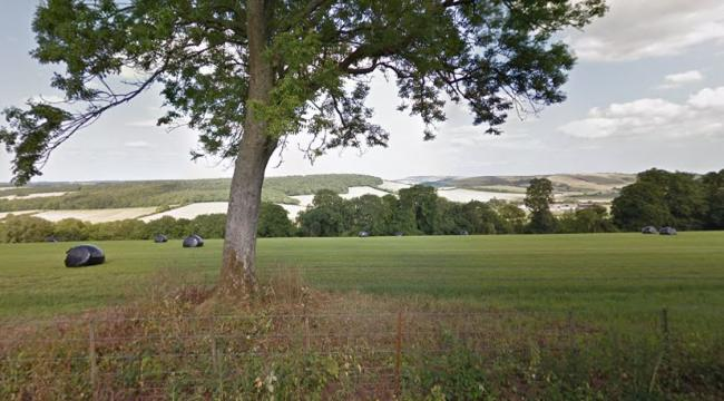 Whitewool Farm: the site is just beyond the woodland in the middle distance. Photo: Google