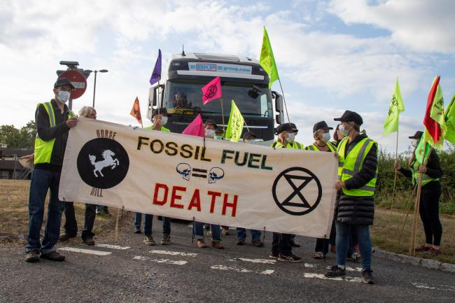 Protesters from Extinction Rebellion obstruct HGVs near to the Horse Hill extraction site in Surrey. Image: XR Surrey