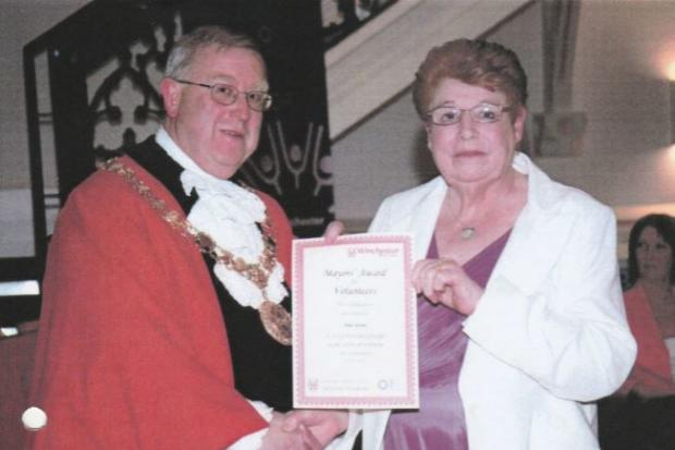 Pam Stevens receiving an award from the Mayor Richard Izard in 2011
