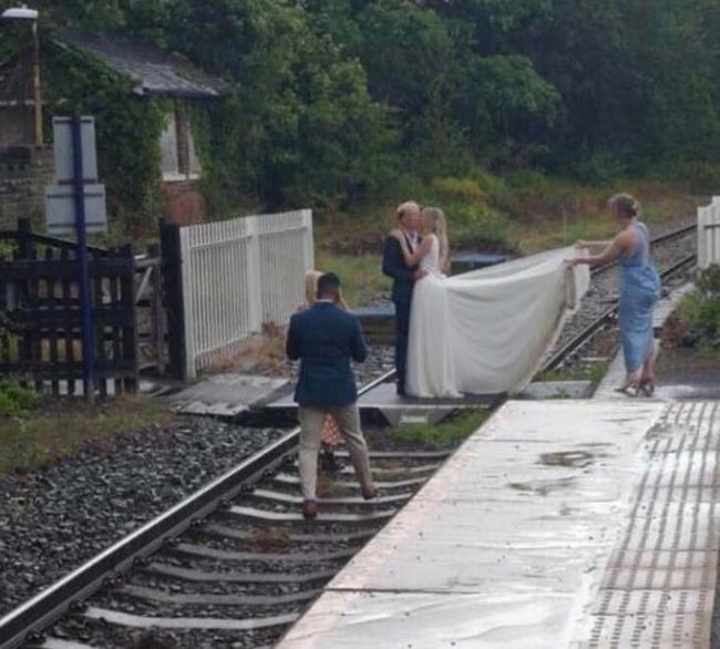 Photo issued by Network Rail of a bridal couple on the track at Whitby, North Yorkshire in July. Network Rail said more than 5,000 trespass incidents were recorded between June and September.