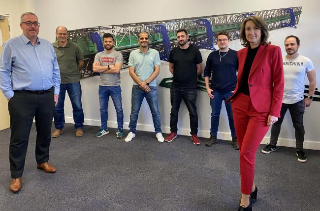 DFS Composites staff including founder Feras Yosef (fourth from left), with OVIC's Stephen Deller (left) and Monica Dabrowska (front right)