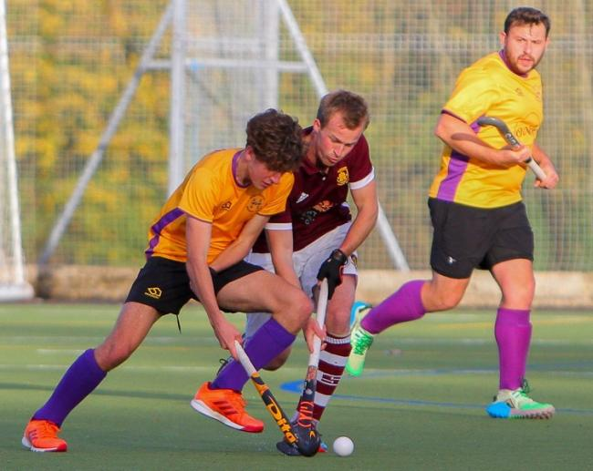 Jonno Jenkinson battles past Guildford with Ben Hibberd waiting for the pass. Picture by Kevin Steele