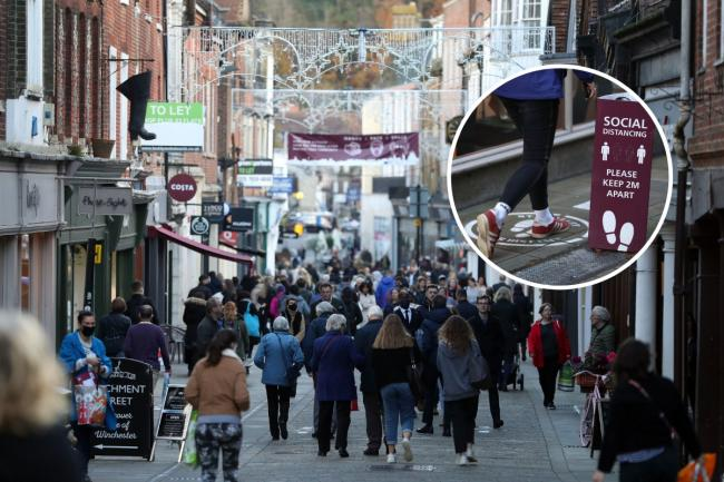 1 Shoppers on Winchester High Street before lockdown begun on Thursday. Inset, social distancing measures in the city centre. Images: Andrew Matthews/PA