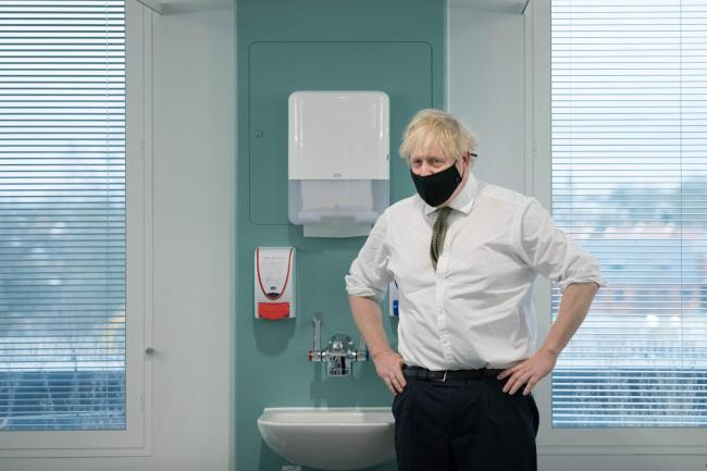 Prime Minister Boris Johnson during a visit to view the vaccination programme at Chase Farm Hospital in north London, part of the Royal Free London NHS Foundation Trust. The NHS is ramping up its vaccination programme with 530,000 doses of the newly appro