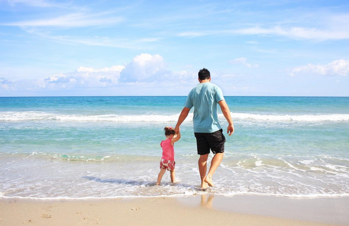 On the beach: father and son