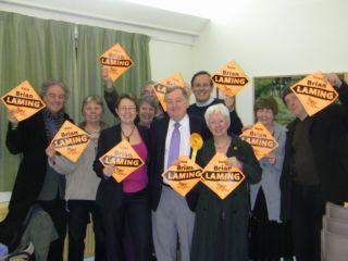 Winners: Brian Laming and Lib Dems celebrating their victory