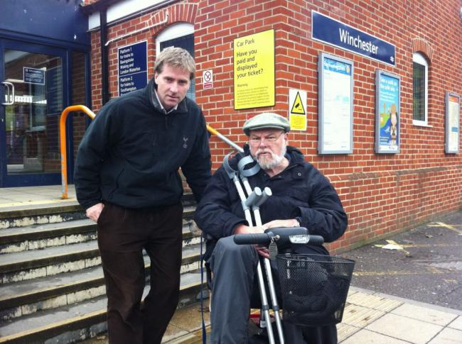 Winchester MP Steve Brine with Brian Espiner, who was told his scooter was 2.75cm too long to be allowed onboard by South West Trains