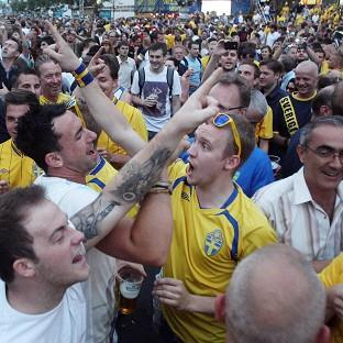 England fans sing to Sweden fans as they mingle with each other in the fanzone in Kiev, Ukraine during Euro 2012