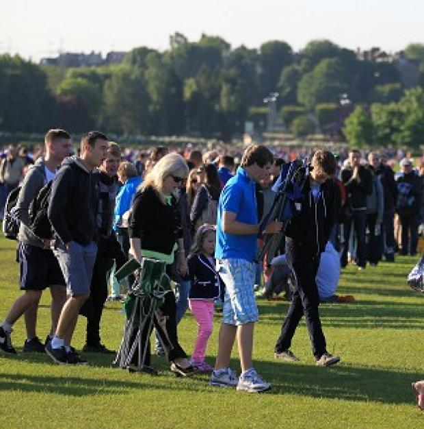 Tennis fans queue for the opening day of the 2012 Wimbledon Championships