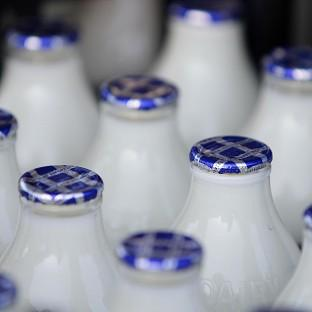 The Co-op has increased the premium it pays to its suppliers for their milk following protests by dairy farmers