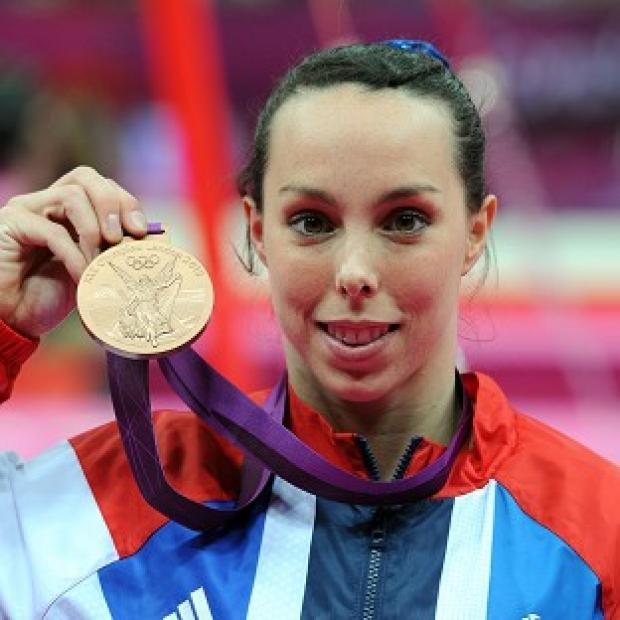 Beth Tweddle celebrates with her Bronze medal after the women's uneven bars final
