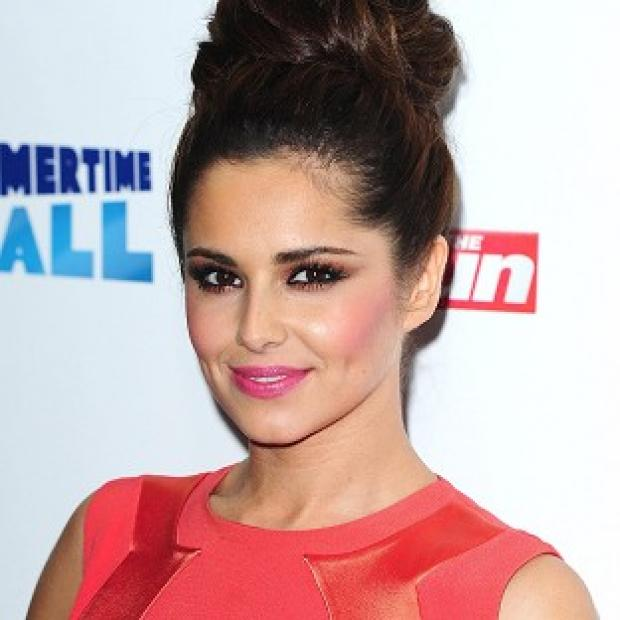 Cheryl Cole has returned to the UK following her car crash in LA