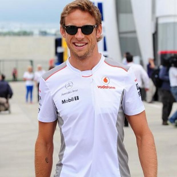 Jenson Button has claimed pole position for Sunday's Belgian Grand Prix