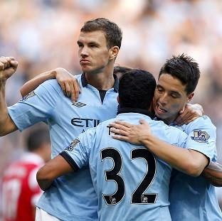 Edin Dzeko, left, bagged the winner for City