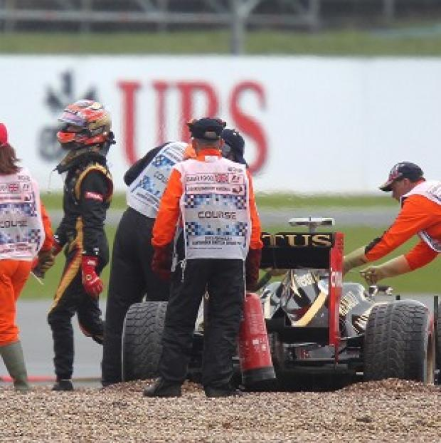 Romain Grosjean, pictured, clipped Lewis Hamilton's McLaren at the start of the Belgian Grand Prix