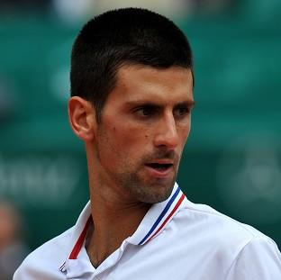 Novak Djokovic comfortably beat Julien Benneteau in the third round of the US Open.