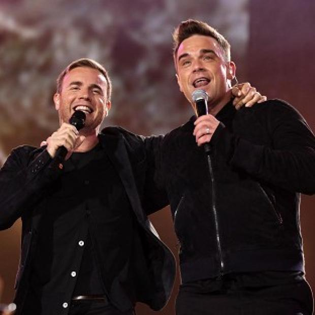 Robbie Williams and Gary Barlow have teamed up again on new song Candy