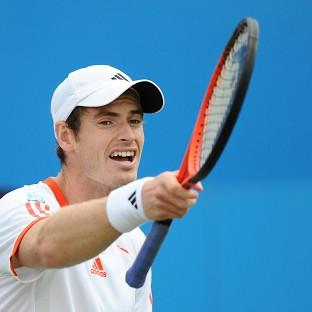 Andy Murray has reached the US Open quarter-finals after dispatchingMilos Raonic in three sets