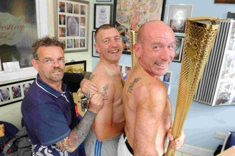 Tattor artist Rob Barfoot with Anton James (centre) and Rob Whittington