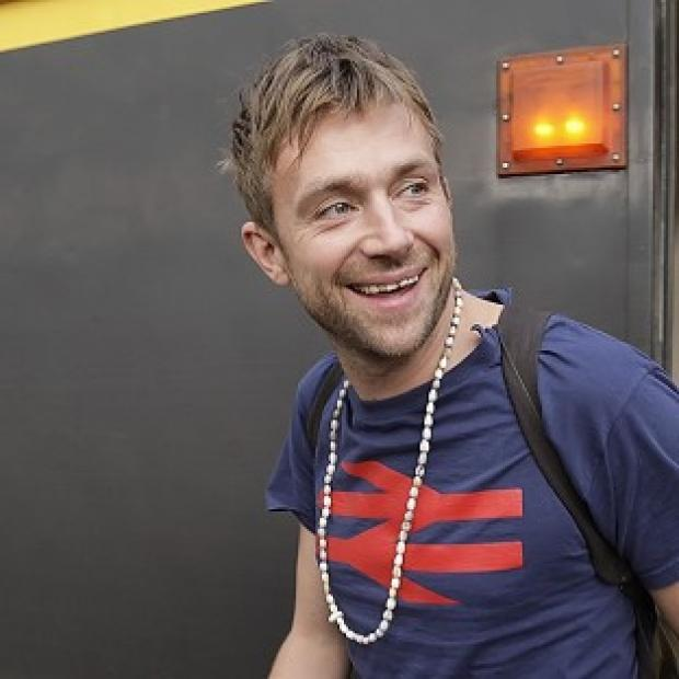 Damon Albarn arrives at Central Station in Glasgow