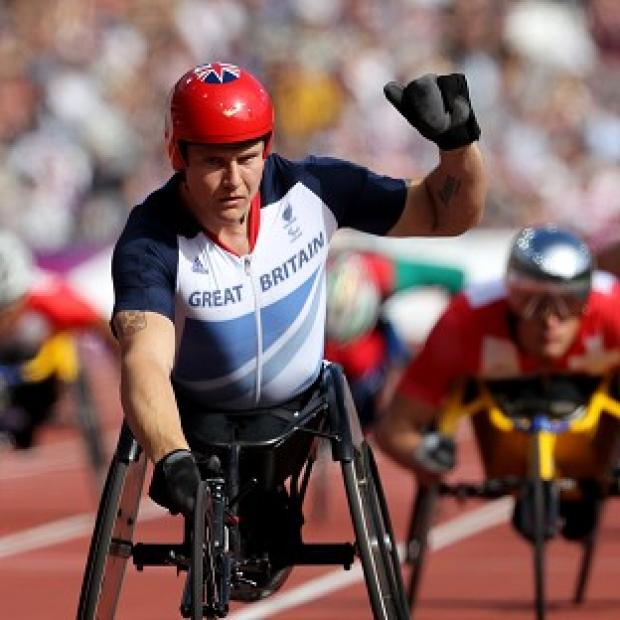 David Weir celebrates finishing first in his T54 800m heat