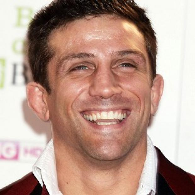 Alex Reid is in police custody after being arrested over a disturbance involving his girlfriend Chantelle Houghton