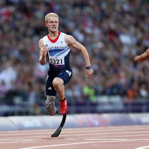 Great Britain's Jonnie Peacock wins his heat in the men's 100m T44 event
