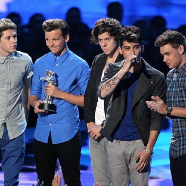 Members of One Direction accept the award for best new artist at the MTV Video Music Awards (AP)