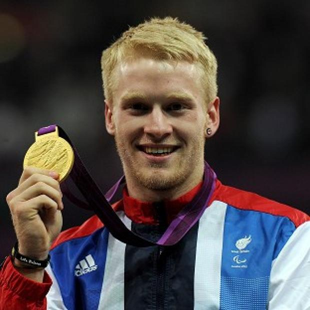 Jonnie Peacock celebrates with his gold medal after winning the 100 metres T44 final