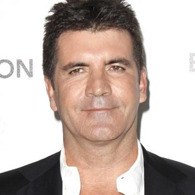 Simon Cowell was apparently worried that Gary Barlow would establish an 'entertainment empire'