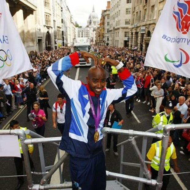 Mo Farah takes part in a parade through London, celebrating Britain's Olympic and Paralympic sporting heroes