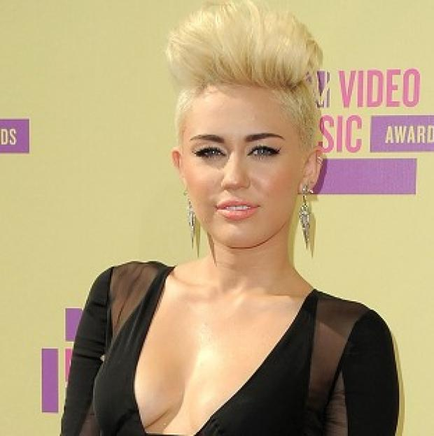A man arrested near the Los Angeles home of Miley Cyrus has been charged with trespassing