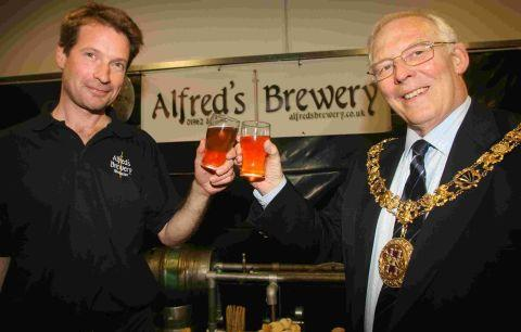 Say 'cheers' for the camera: Steve Haigh, left, and Mayor of Winchester Frank Pearson.