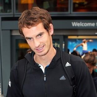 US Open winner Andy Murray arrives back at Terminal 5 at Heathrow