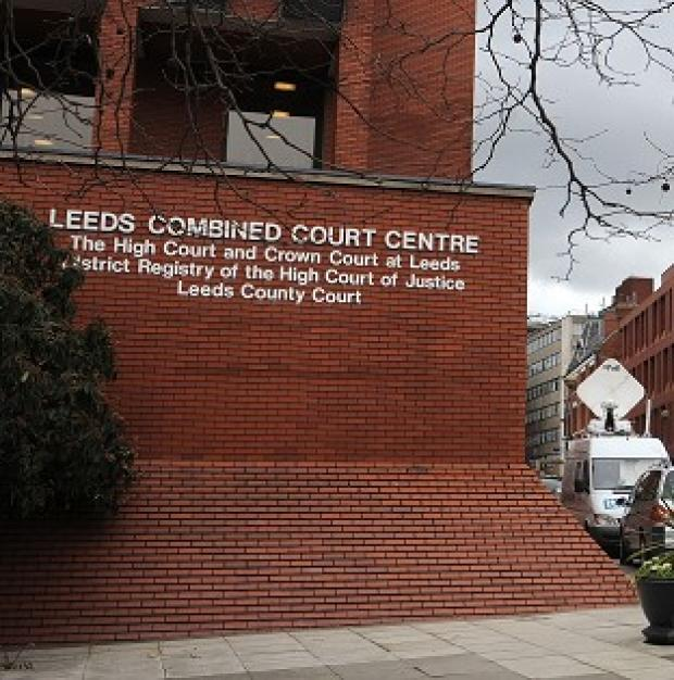 At Leeds Crown Court, Richard Barnes denies murdering his baby daughter
