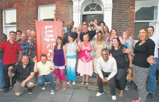 Voice FM staff celebrate the radio station's first birthday.