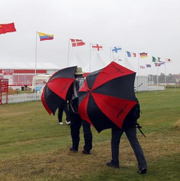 Members of the public brave the bad weather during the Ricoh Women's British Open