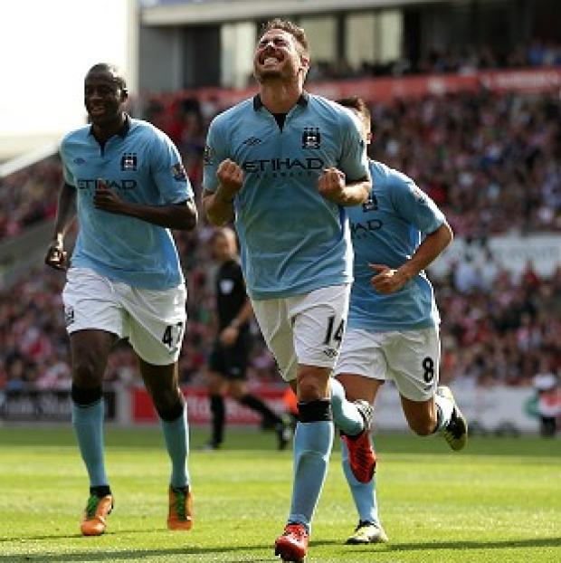 Debutant Javi Garcia scored Manchester City's equaliser at Stoke