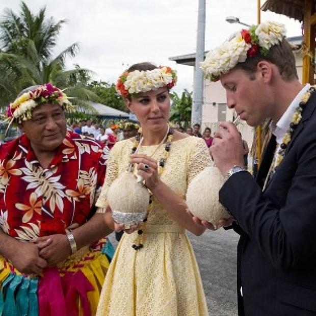The Duke and Duchess of Cambridge drink from a coconut during a visit to Tuvalu village (Arthur Edwards/The Sun/PA Wire)