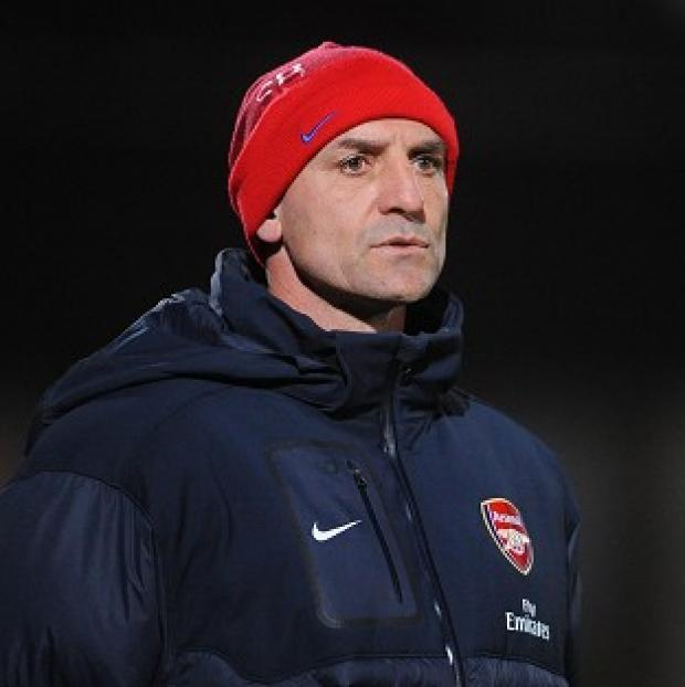Steve Bould, pictured, described Lukas Podolski as one of the best finishers he has seen