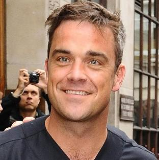 Robbie Williams said if his daughter has good manners 'she can get away with murder with me'