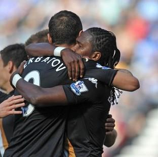 Hugo Rodallega, right, is congratulated by Dimitar Berbatov, centre, on scoring his team's first goal