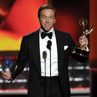 Homeland star Damian Lewis picks up the Outstanding Lead Actor In a Drama Series award at the Emmys (AP)